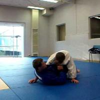 Straight armwrap Armlock from Guard